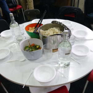 Round table set for meal of six